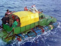 Happy Cubans sailing their yacht to unhappy America