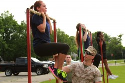 Janna Smith, an 18 year old Marine Corps poolee from Recruiting Sub-Station Livonia, conducts the flexed-arm hang during Recruiting Station Detroit's bi-annual female pool function at the Boys and Girls Club of Troy, Mich., June 20, 2015. The flexed arm hang is the first of three events the poolees performed during their Initial Strength Test. (U.S. Marine Corps photo by Cpl. J.R. Heins/Released)