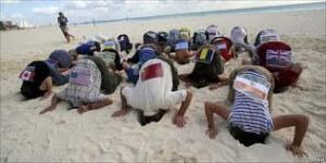 cancun heads in sand