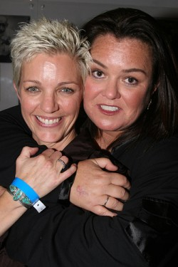 Kelli Carpenter smiles for the camera as Rosie O'Donnell attempts to strangle her