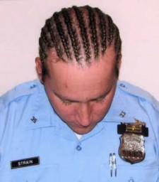 Officer Thomas Strain was accused of misappropriating a black man's haircut