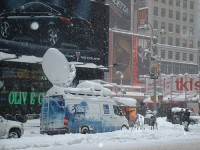 Weather Channel van experiencing global warming first hand in Times Square. Photo by Flickr's condour